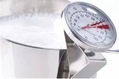 milk frothing thermometer in jug of milk