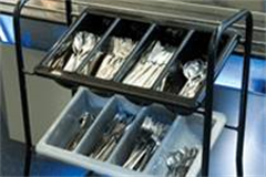 A cutlery box box filled with various types of cutlery