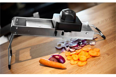 mandolin with sliced carrots and onions