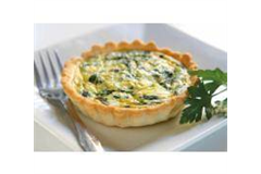 quiche on a small plate with a afork
