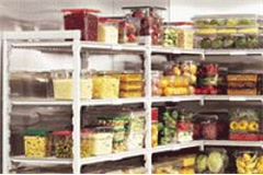 wire shelving full of clear containers of food