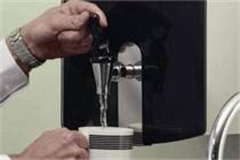 water boiler dispensing water into a cup