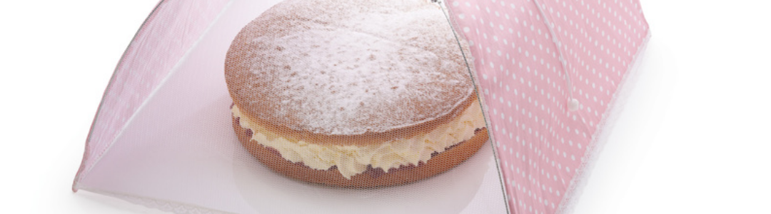 ink net food cover covering a Victoria sandwich