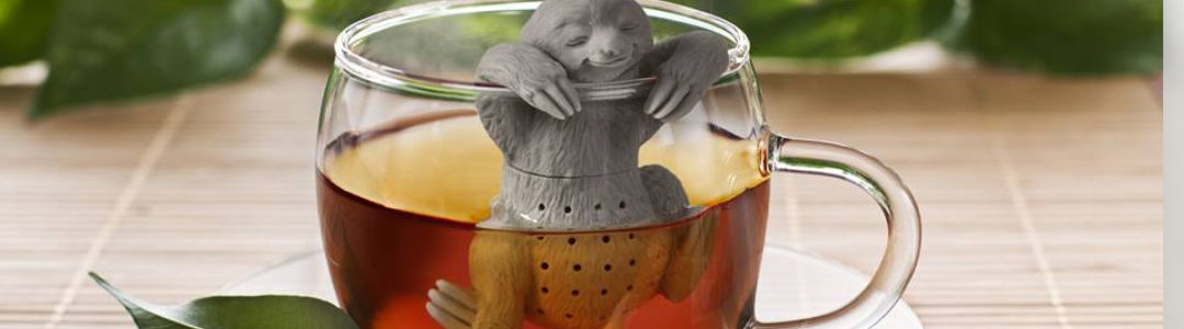 Sloth slow brew tea infuser in a glass tea cup