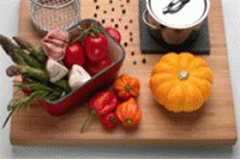 a chopping board with various condiments on it