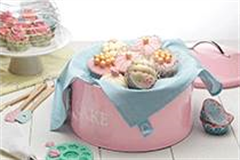 cake tins with cupcakes
