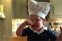 toddler with chefs hat on