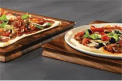 one circular and one square plate on wooden serving boards