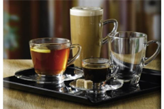 an assortment of four coffee glasses on a square plate