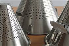 variety of different sized stainless steel conical strainers