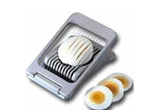 an egg being sliced by a egg slicer