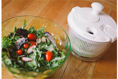 salad spinner next a bowl of salad