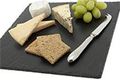 a large square slate with various cheeses on alongside a cheese knife