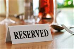 reserved sign on a table top