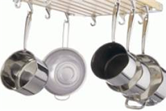 stainless steel pots hanging from a tool rack