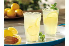 tumblers filled with a lemonade drink accompanied by lemons