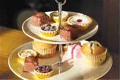 variety of cakes on a cake stand