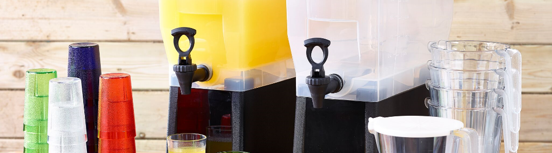 two drinks dispenser, one filled with orange juice, plastic cups also on table